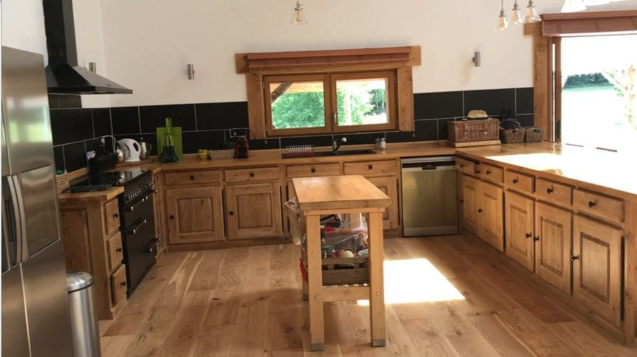 The country kitchen, with plenty of room and lots of work surface, with views out over the large outdoor terrace patio.