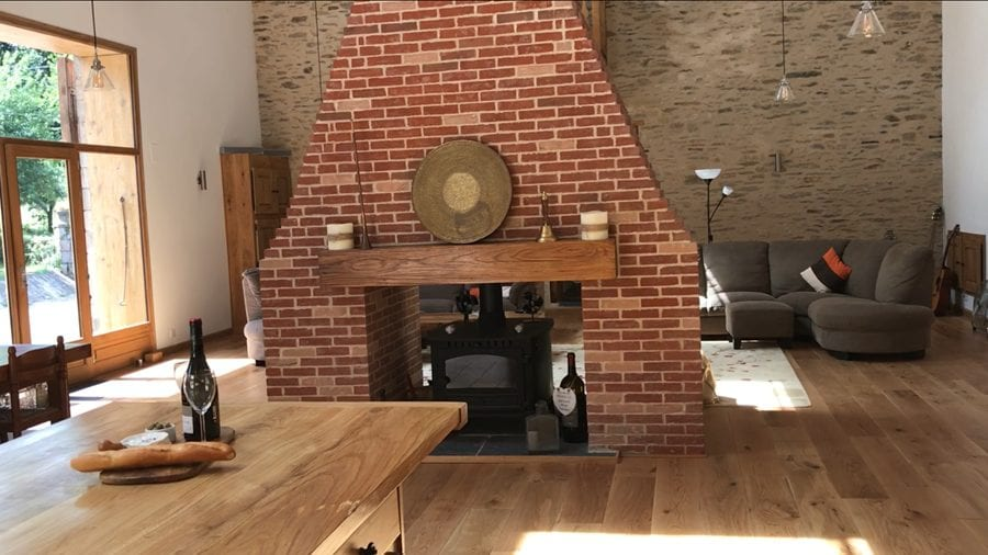View from the Gite kitchen, of the central chimney and lounge beyond the chimney