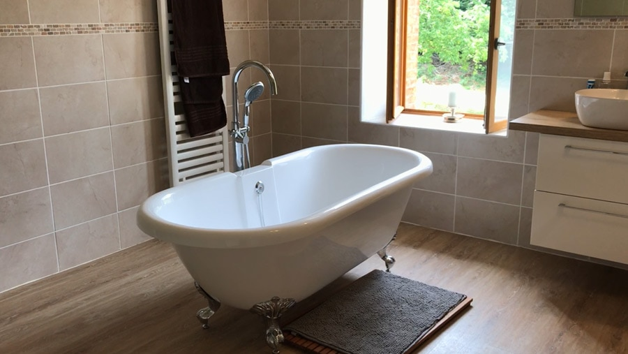 Masterbed Ensuite Bathroom. Beautiful victorian bath on legs, with view outside across the upper orchard.