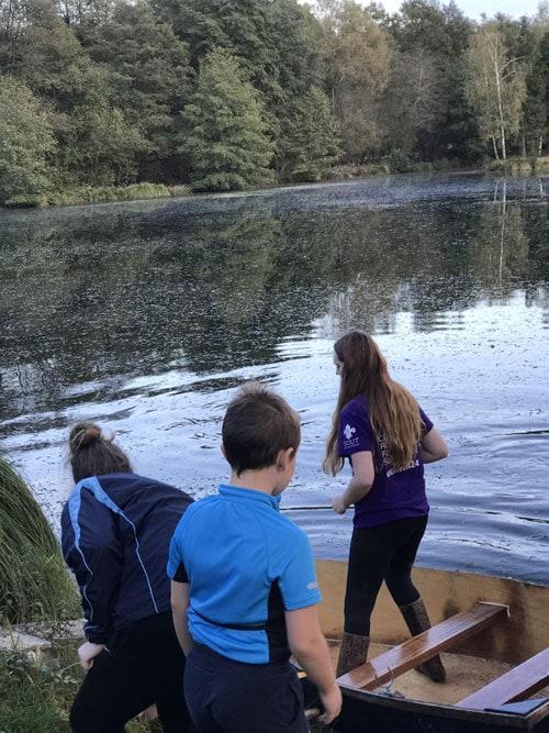 Kids boating on the lake